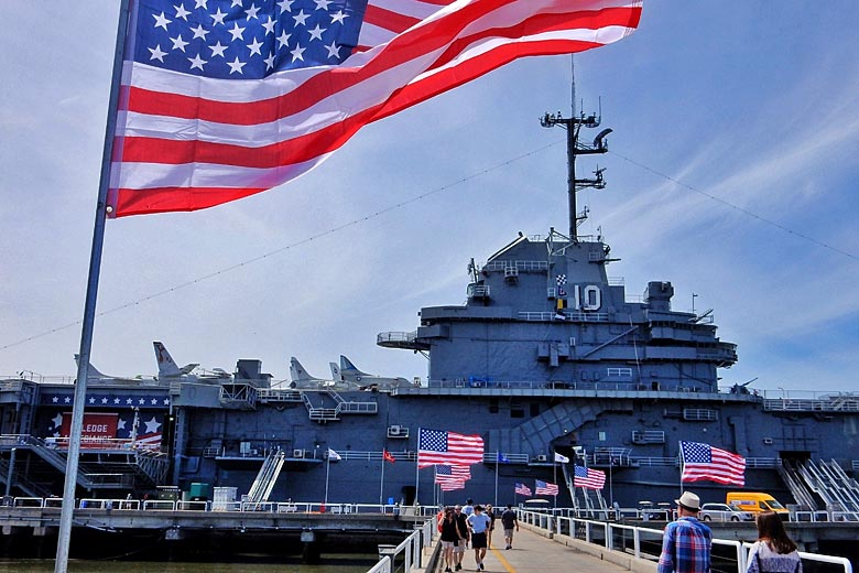 Walk the alley of flags to the USS Yorktown at Patriots Point © Kirsten Henton