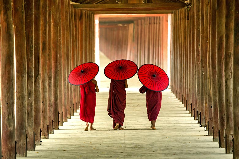Colourful monks on the move in Myanmar © Sutipond Stock - Adobe Stock Image