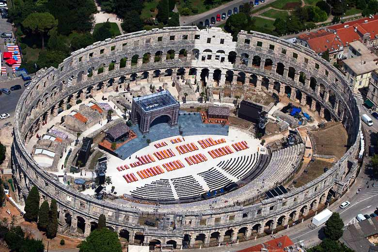 Stage set for a concert in the Roman amphitheatre in Pula, Istria © Jeroen Komen - Wikimedia Commons