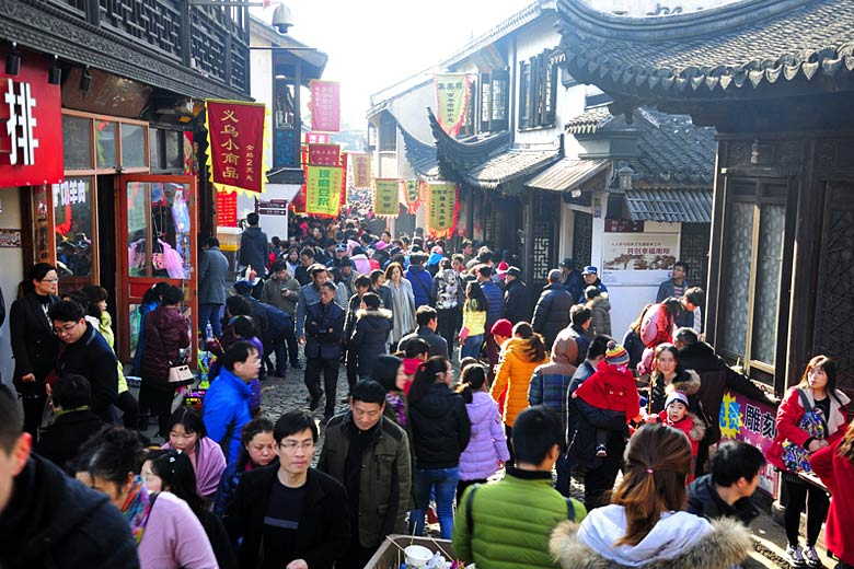 Crowded street in the old town of Nanxiang, Shanghai © Tempestz - Dreamstime.com