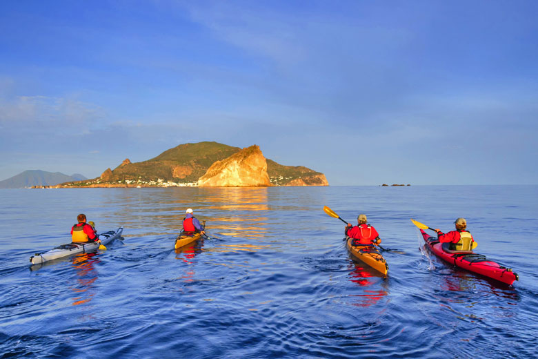 Early morning paddle in the Aeolian islands, Sicily © A Rochau - Fotolia.com