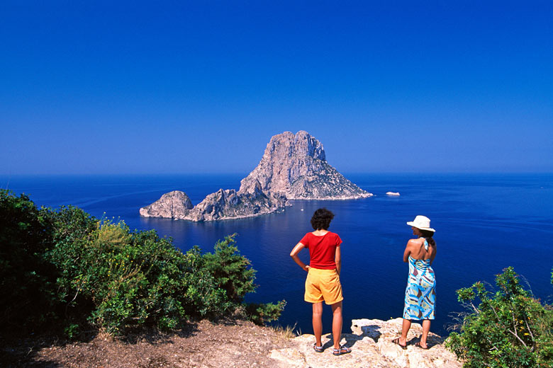 The rocky island of Es Vedrà off the southwest tip of Ibiza © imageBROKER - Alamy Stock Photo