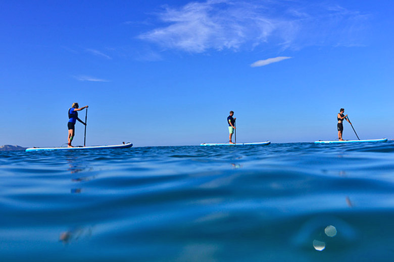 When the sea is calm stand up paddleboarding is a great way to explore - photo courtesy of Mark Warner