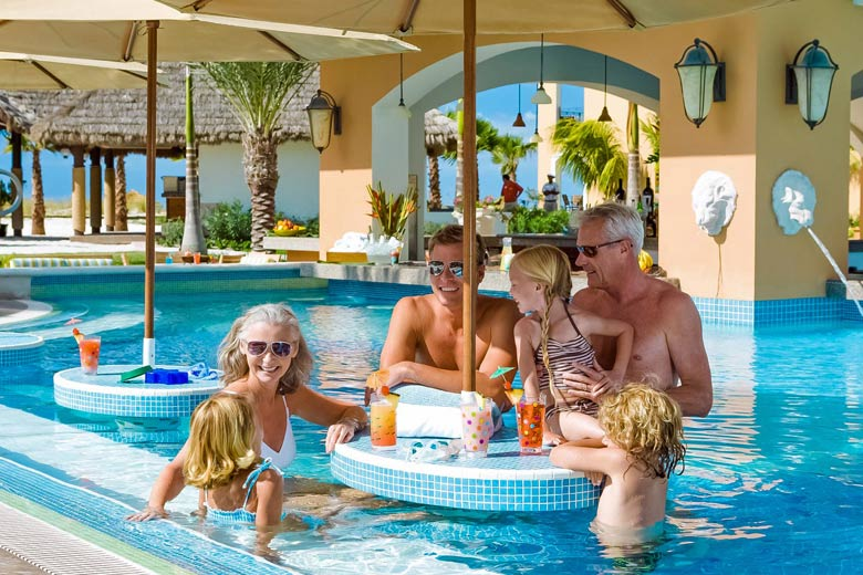 Family relaxing in one of the many pools at Beaches Turks & Caicos - photo courtesy of Beaches