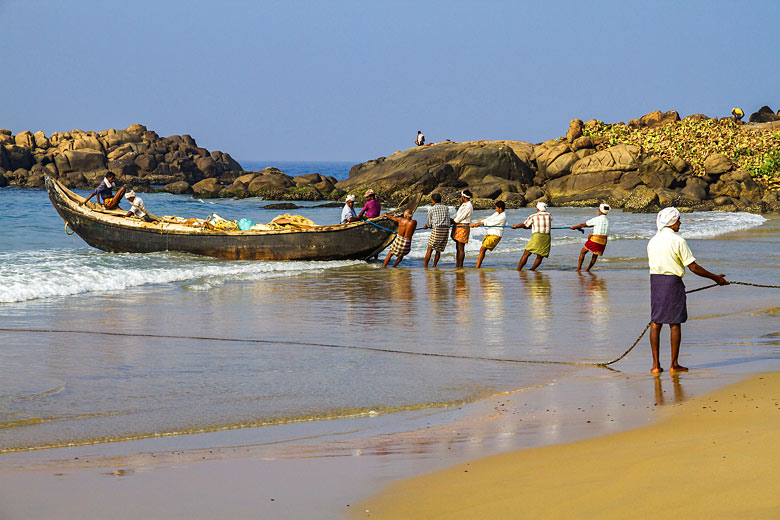 Fishermen landing their catch on Kovalam beach, Kerala © Rudi Ernst - Fotolia.com