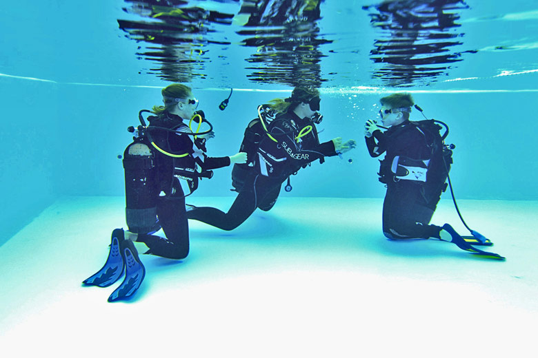 Learning the basics of scuba in the pool with Mark Warner - photo courtesy of Mark Warner