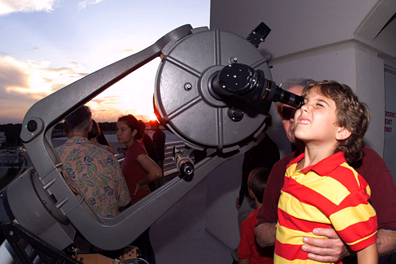 Looking through a telescope for the first time - photo courtesy of the Orlando Science Centre