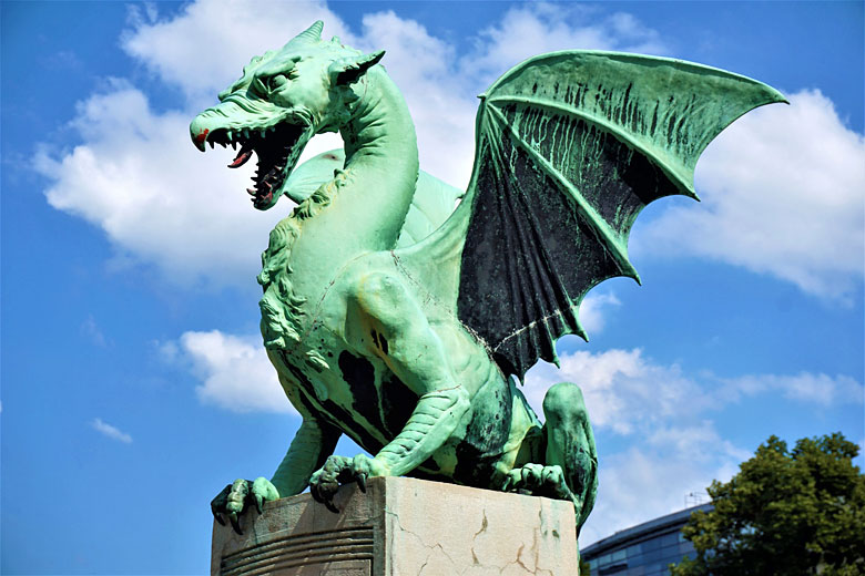 One of four dragons on the Dragon Bridge in Ljubljana, Slovenia © Travelguy - Fotolia.com