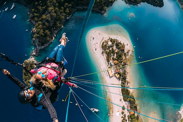 Parascending on to Olu Deniz beach, Turkey - photo courtesy of Hüseyin Burak Tuzer