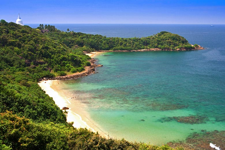 The Peace Pagoda with Jungle Beach below, Sri Lanka © nobleIMAGES - Alamy Stock Photo