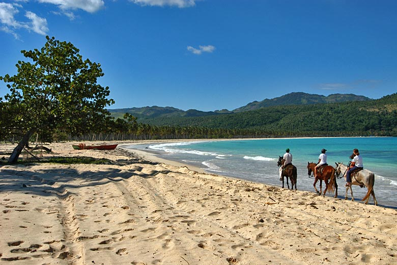 Riding on the beach of Playa Rincon, Dominican Republic © Stefano Ember - Dreamstime.com