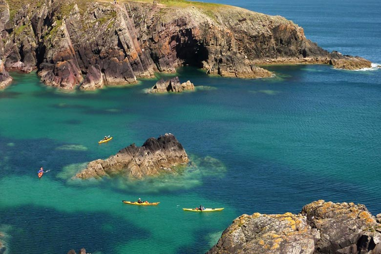 Sea kayaks exploring the coast - photo courtesy of Pembrokeshire Coast National Park Authority