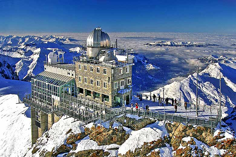 The Sphinx Observatory perched high on the Jungfraujoch © Julius Silver - Wikimedia Commons