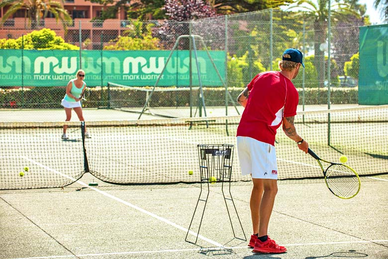 Take a tennis lesson from a pro at San Lucianu Resort - photo courtesy of Mark Warner