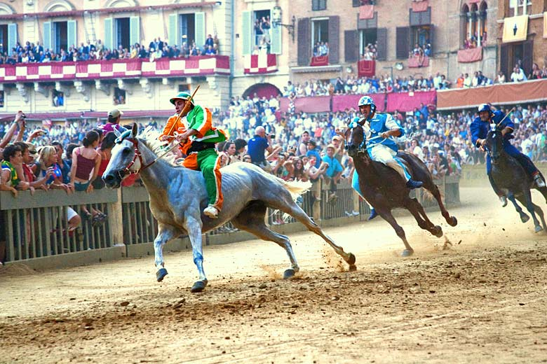 The Palio is run around the main square of Siena © Odyssey-Images - Alamy Stock Photo