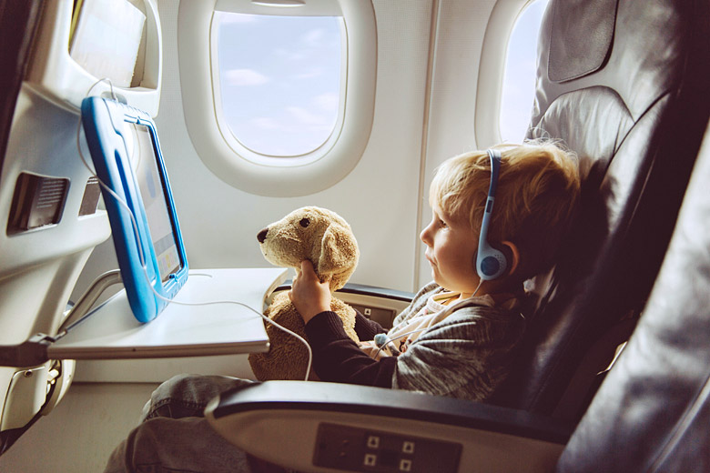 Today's long haul flights are packed full of entertainment © Westend61 GmbH - Alamy Stock Photo