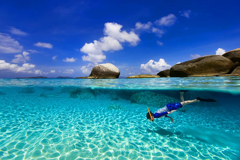 Young boy snorkelling in a warm clear tropical sea © BlueOrangeStudio - Fotolia.com